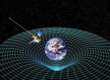 To-dimensjonal «rubber sheet»-analogi av romtidskrumning som er forårsaket av et objekt med masse. Kilde: NASA (http://upload.wikimedia.org/wikipedia/commons/d/d1/GPB_circling_earth.jpg)